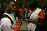 Taray Hall, left, sophomore, and Ain Ealey, right, junior, work their text messages in the hallway...