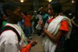 Taray Hall, left, junior looks at a text message on the phone of Ain Ealey, right, sophomore, in...