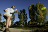 DM1843     Joseph Wharton tees off as he and several other players from Mile High Disc Golf...