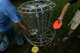 DM1850     Disc Golf players from Mile High Disc Golf play in Lakewood Gulch. The course opened in...