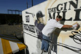 DM0070     Artist Adam Moorhead puts the finishing touches on a 20-foot mural of Colorado Rockies'...