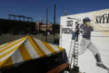 DM0154     Artist Adam Moorhead puts the finishing touches on a 20-foot mural of Colorado Rockies'...