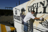 DM0068     Artist Adam Moorhead puts the finishing touches on a 20-foot mural of Colorado Rockies'...