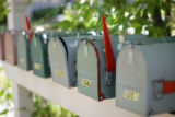 Mailboxes are grouped together in front of the 14 cottage houses in the Poplar community in...