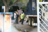 Unidentified workers remove furniture from the old Children's Hospital location on Monday October...