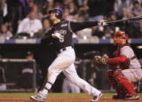 [3781]  Colorado Rockies Matt Holliday hits a long fly ball for an out in the eighth inning of...