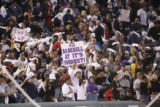 [4330]  Colorado Rockies fans hold up signs before Game 4 of the World Series on Sunday evening,...