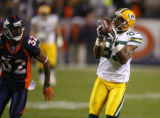 DM1418   Green Bay Packers receiver Greg Jennings pulls in touchdown pass from Brett Favre to win...