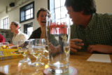 Brian Dunn, Eric Warner, J. Todd Usry, (cq all three), chuckle over who chose which beer in their...