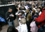 0137 Colorado Rockies manager Clint Hurdle signs autographs as a few members of the team join...