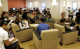 Students study in the Information Commons outside of the William M. White Library Wednesday...