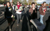Krystan Bruce (cq) left, out of frame, and Sally Barto (cq) right carry a headstone off of campus ...