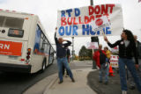 DM0018     Earl Kastning, left, and other demonstrators taunt an RTD bus as it rolls by a bake...
