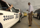 (DENVER, Colo., August 30, 2004) Abduhl Hajy, Somalia, looks back at another driver taking a break...