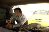 (DENVER, Colo., August 30, 2004) David Kumm works a remote control from the back of his van in...