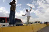(DENVER, Colo., August 31, 2004) Chinbayar Sergelen, Mongolia, takes a balancing exercise walk...