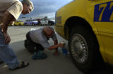 (DENVER, Colo., August 31, 2004) Mike, russia, and Stan, a driving colleague, work together to...