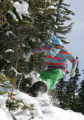 Andrew Hook (cq) from Breckenridge, pops a jump along the edge of Mambo Tuesday afternoon. It's...