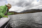 Jane Kemp (cq) uses a Secchi disc to measure the water clarity of Grand Lake, a once pristine...