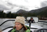 Steve Paul (cq) drives his ski boat on Grand Lake with fellow resident Jane Kemp (cq) (at left)....