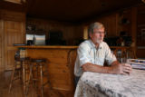 John Stahl (cq) talks to a reporter inside his Grand Lake cabin. He is the President of the Grand...