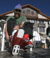 Tim Chappell (cq), from Leadville takes off his boots after doing a couple of runs Friday morning,...