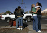 Valerie Amancio (cq), 17, second from the right, a junior at Ranum High School, comforts her...
