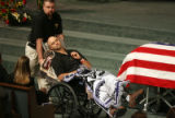 Colorado State Patrol Trooper Scott Hinshaw (cq) (wheelchair) leaves  the funeral of fellow...
