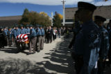 The body of Zachariah Templeton (cq) is carried into the hearse that awaits outside of the...