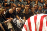 (far left on wheel chair) Colorado StateTrooper Scott Hinshaw (cq), 38, gets emotional at the...