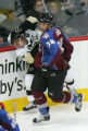 Kurt Sauer hits Sidney Crosby in the second period of the Colorado Avalanche against the...