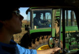 MJM298  Weld County farmer, Mark Nygren (cq), center, rides his tractor Friday morning 10/19/07 as...