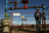 MJM337  Weld County farmer, Mark Nygren (cq) stands near one of the several oil and natural gas...