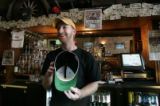 0271 Gin Mill Bartender Zach Ross, CQ, 27, of Arvada, proudly holds a Colorado Rockies cap with...