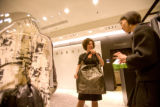 (Denver, Colo., Oct. 17, 2007) Janice Gates gets excited about a Marni handbag, assisted by sales...