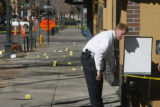 Denver Police and CSI review the crime scene at the corner of 15th and Market St where eight...