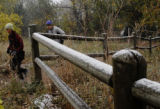 Despite snowy conditions, people ventured into the mountains for a day hike on Sunday, October 21,...