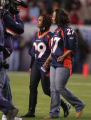 Kim Nash, wife of late broncos player Damian Nash , wearing #29, and Rosalind Williams, Darrent...