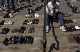 (8/31/2004) New York City-Arthur Sadowski, Brooklyn, polishes a pair of boots bearing the name of...