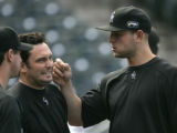 0442 Colorado Rockies pitcher Josh Fogg, left, and Matt Holliday keep things light as the team...