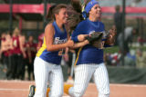 Wheatridge outfielders #21 left, Melanie Castillo and #10 mandy Sivetts  celebrate a shut out ...