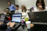 Debbie Vargo (cq), right, bites her nails as she tries to buy Rockies world series tickets Monday,...