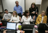 Debbie Vargo (cq), seated second from right, crosses her fingers as she was able to get to the...