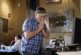 Rockies fan James Foy (cq), of Denver, prays as he attempts to buy tickets for the World Series at...