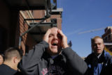 Jeffrey Morse (cq), of Golden boos with other fans at Coors Field in Denver, Colo. during the...