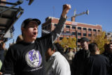 Rockies fans Alex Leaming (cq) boos outside Coors Field in Denver, Colo. during the announcement...