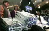 E.B. and Sandy Mull (cq) shop for Rockies shirts at  Where The Buffalo Roam, in downtown Denver...