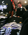 Casey Jones (cq) looks through the hats as he  shops for Rockies wear  at  Where The Buffalo Roam,...