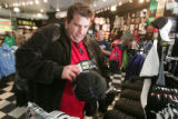 Dave Rappe  (cq) looks through the hats as he  shops for Rockies wear  at  Where The Buffalo Roam,...