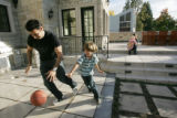 Club owner Francois Safieddine (cq), plays basketball at home with his son Jamil, 7, in their...